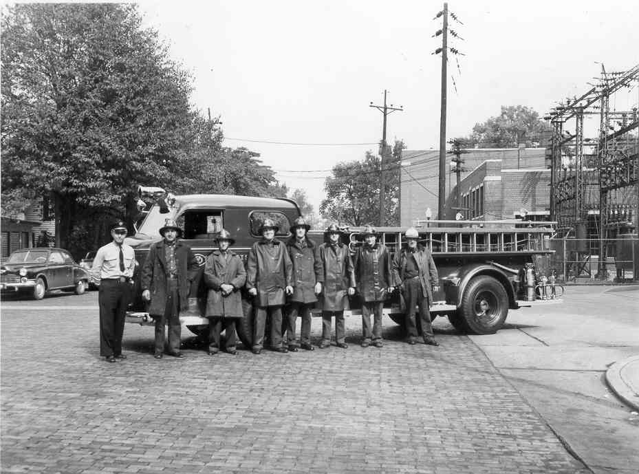 Vintage photo of Mishawaka Fire Department with fire truck, 1940.