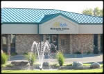Entrance to Mishawaka Water Department with small pond and fountain