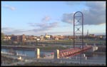 Panoramic picture of the city of Mishawaka with Pedestrian Bridge across St. Joseph River in foreground